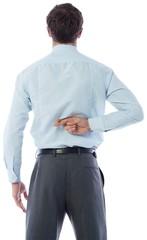 Businessman crossing fingers behind his back