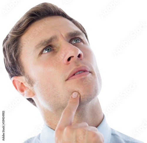 Thinking businessman with finger on chin