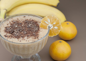 Cocktail of banana, tangerine with yogurt and chocolate.