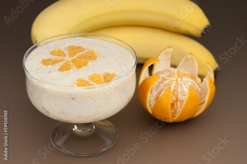 Cocktail of banana with  tangerine and yogurt.