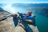 Happy family on  Preikestolen massive cliff top (Norway)