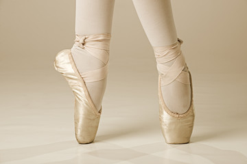 Ballet dancer feet - gold
