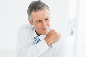 Close-up of a mature man suffering from shoulder pain