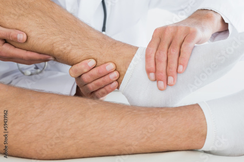 Extreme close-up of a man getting his ankle examined