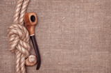 Ship rope, seashells and tobacco pipe