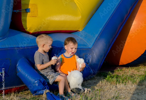 Two young friends eating candy floss