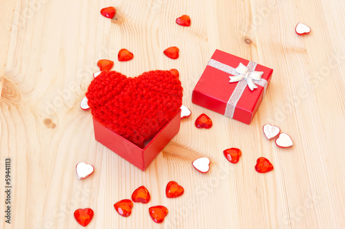 box with a cute red knitted heart