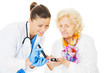 Doctor Examining Senior Woman's Blood Sugar