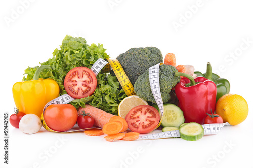 assortment of vegetable and measuring tape