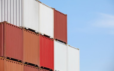 cargo containers in storage area of freight sea port terminal