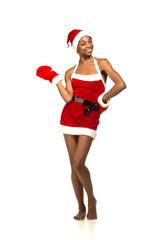 Christmas afro american woman wearing a santa hat smiling