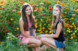 Teen girls on a background of flowers