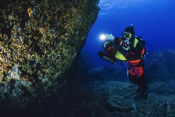 Italy, Ponza Island, Tyrrhenian sea, filming scuba diver