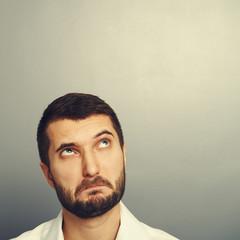 perplexed man looking at copyspace