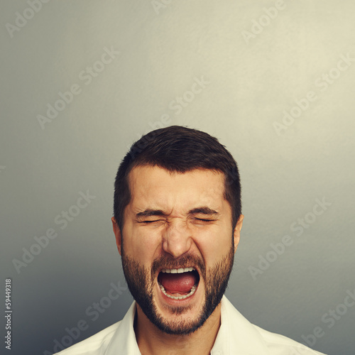 screaming man over grey
