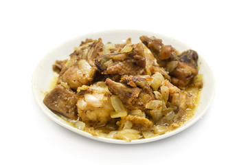 Fried chicken with onion on a plate