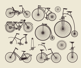 set of old bikes on a gray background