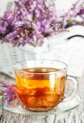 Cup of tea and branch of heather
