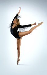 Beautiful ballet dancer doing an arabesque