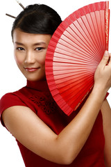 Traditional asian woman holding a red beautiful fan