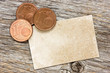 Copper euro cents with paper card