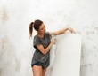 Young beautiful brunette woman brush and wallpaper