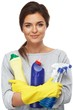 Beautiful  woman in gloves with cleaning sprays