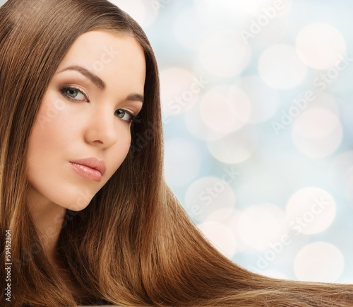 Beautiful young girl with long over blurred background