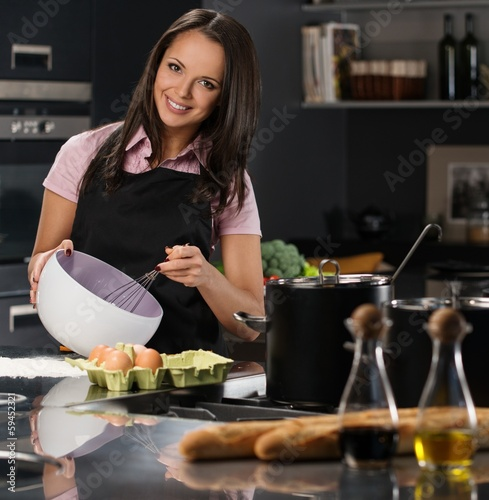 Young woman on a modern kitchen