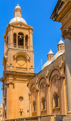 Side view of the Paola parish church ant its tower in Malta