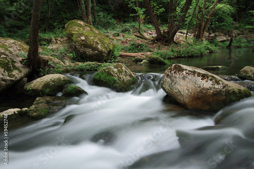 Silky river flow near waterfall known as Santa Margarida