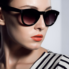 The beautiful woman in sunglasses