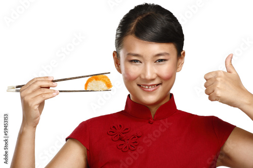 Chinese woman showing asian food using chopstick - 59453153