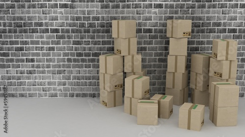 modern brick wall background with cardboard boxes