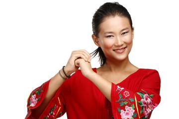 Chinese woman greeting gesture in elegant red dress