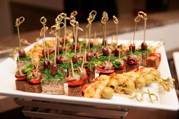 Various snacks in plate on restaurant table