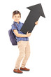 Full length portrait of a schoolboy holding a big black arrow