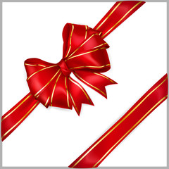 Red bow with diagonally ribbons with golden strips