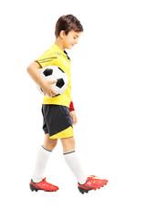 Full length portrait of a sad kid in sportswear posing with a ba