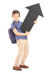 Full length portrait of a schoolboy holding a big black arrow