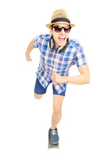 Excited guy with hat and sunglasses skating on a skate board