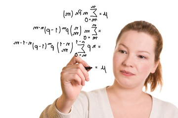 Woman writing mathematical formula