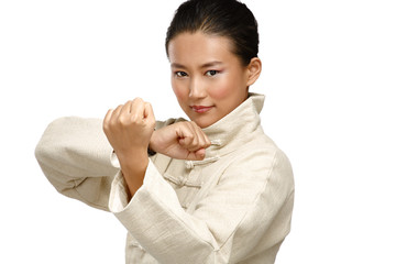 Beautiful asian woman make kung fu gesture