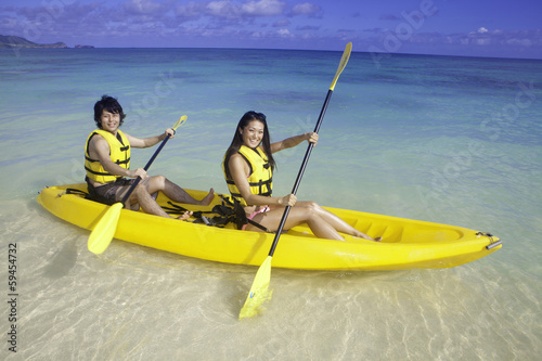 japanese couple in kayak