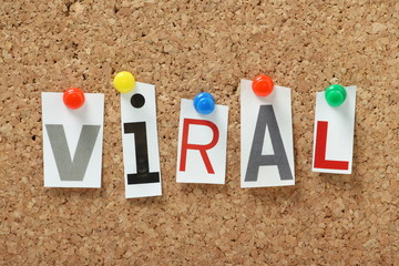 The word Viral on a cork notice board