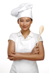 Happy smiling asian chinese woman chef at work