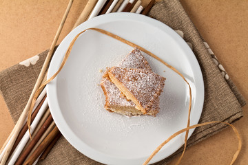 Cake on white plate and wooden table