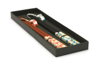 Set of Two Pairs of Chopsticks in Black Case isolated on white