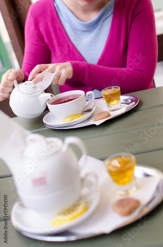 Beautiful young women drinking tea on a porch