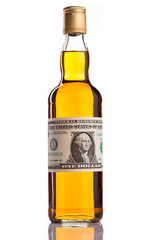whisky and money isolated on white